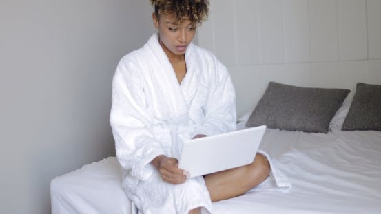 Thumbnail for Woman with Laptop in Bed