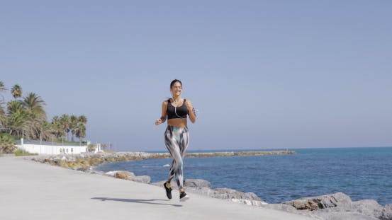 Thumbnail for Cheerful Sportswoman Running on Coastline