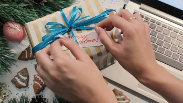 Thumbnail for Woman Put Congratulation Memo To Gift Box