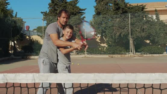 Thumbnail for Father and Son Playing Tennis on Court, Tennis Training
