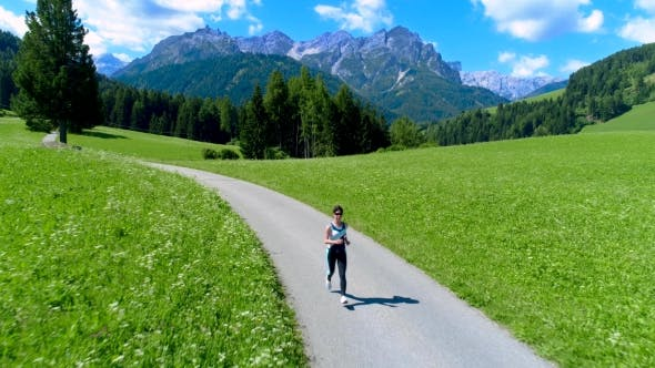 Cover Image for Woman Jogging Outdoors. Italy Dolomites Alps