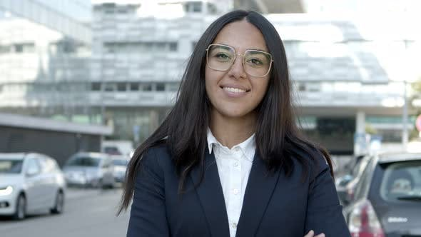 Thumbnail for Attractive Young Businesswoman Smiling at Camera