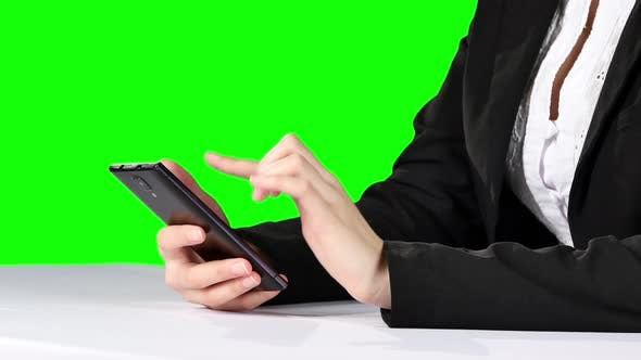 Cover Image for Businesswoman Touching Smartphone. Green Screen