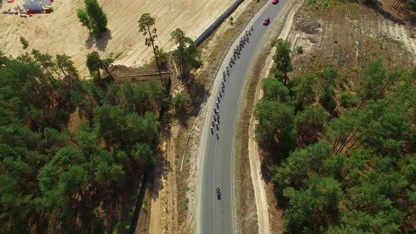 Thumbnail for Cycling Race on Country Road. Drone View Group Cyclists Racing Highway