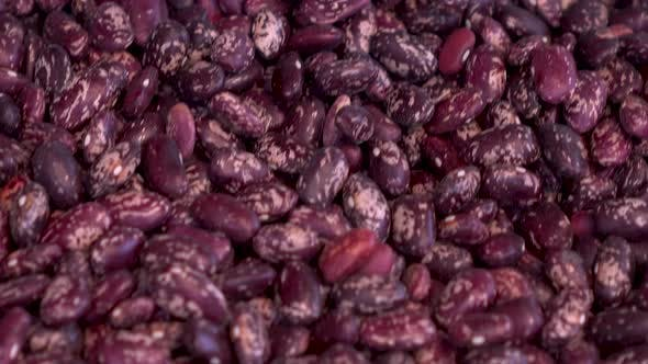 A Pile of Red Beans on the Market Close-up. The Camera Moves.