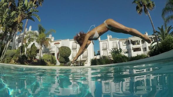 Thumbnail for Woman Jumping To Pool