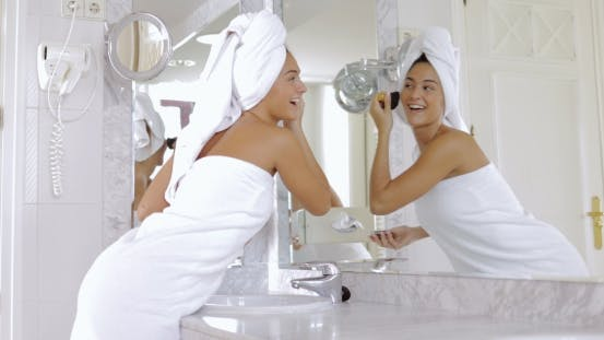 Thumbnail for Laughing Woman Doing Makeup in Bathroom