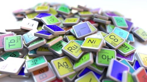 Iron Fe Block on the Pile of Periodic Table of the Chemical Elements Blocks