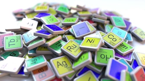 Ytterbium Yb Block on the Pile of Periodic Table of the Chemical Elements Blocks