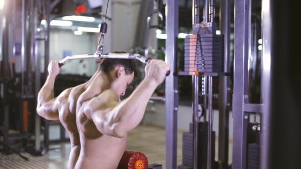 Thumbnail for Brutal Man Using The Lat Pulldown Machine