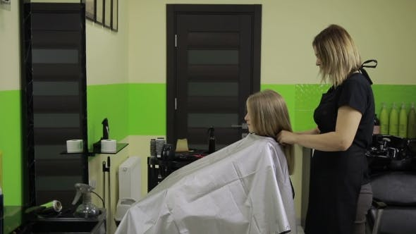 Thumbnail for Smiling Girl Having Her Hair Done By Hairstylist