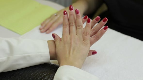 Thumbnail for Woman Showing Her Red Gel Manicure in Beauty Salon