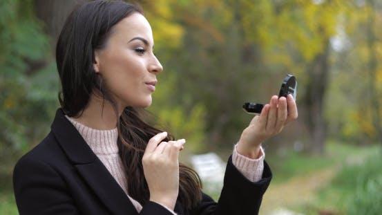 Thumbnail for Woman Looking at Pocket Mirror