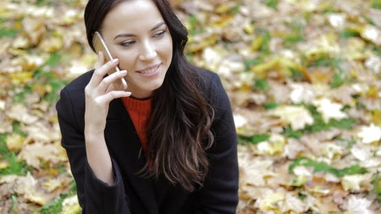 Thumbnail for Woman Speaking on Phone on Grass