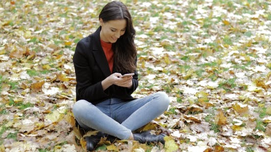 Thumbnail for Woman Using Smartphone on Grass