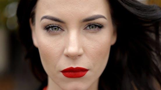 Serious Woman with Vivid Makeup