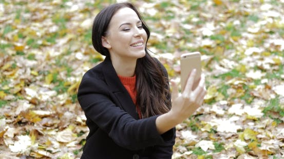 Thumbnail for Woman Taking Selfie on Grass