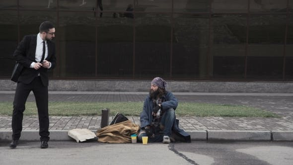 Thumbnail for Businessman Offering Job To Homeless