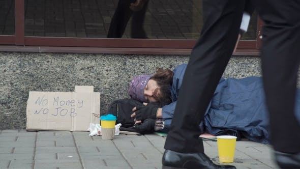 Passerby Giving Money To Beggar