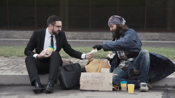 Thumbnail for Businessman Sharing Food To Homeless