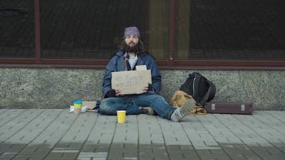 Homeless with Cardboard on Street