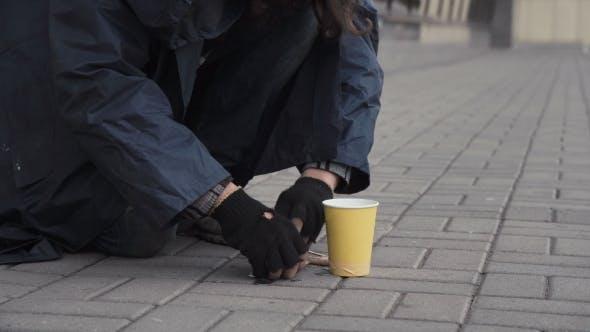 Beggar Picking Change