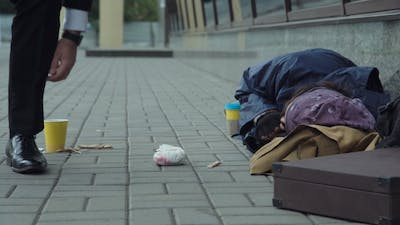 Passerby Giving Food To Homeless
