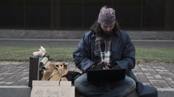 Thumbnail for Poor Man Typing on Laptop