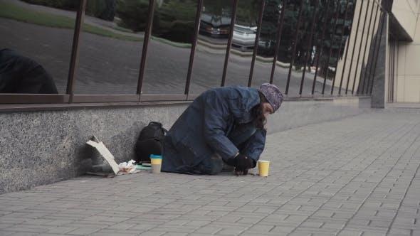 Thumbnail for Beggar Picking Change.