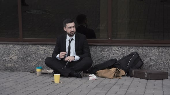 Cover Image for Man Wearing Suit Begging in Street.