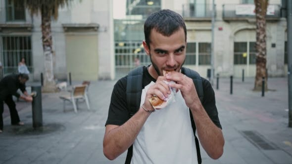 Cover Image for Hungry Student Eats Sandwich on His Way