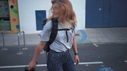 Tourist Girl Walks with Camera