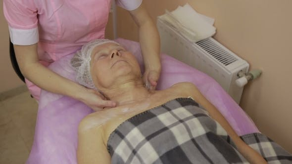 Thumbnail for Relaxed Elderly Woman Getting Spa Massage