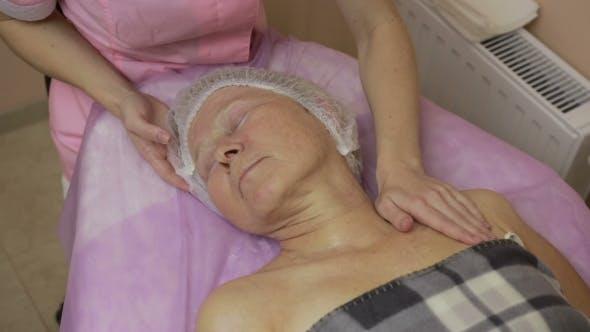 Thumbnail for Senior Lady Enjoying Massage in Beauty Salon