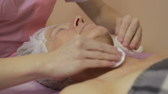 Beautician Makes Facial Cleansing and Exfoliating