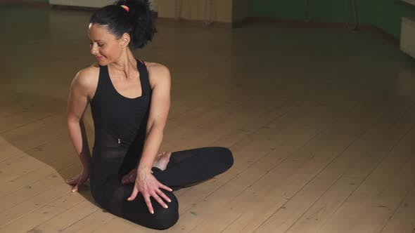 Thumbnail for Relaxed Beautiful Happy Woman Practicing Yoga in the Evening at Home