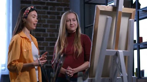 Female Painter Discussing Artwork with Friend