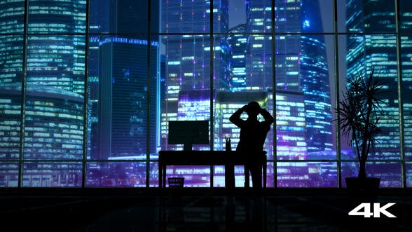 Thumbnail for Silhouette Of A Man Working Late In The Office
