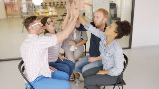 Thumbnail for Colleagues Giving High-five