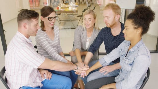 Thumbnail for Group of People Holding Hands Together