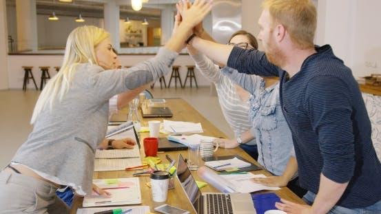 Thumbnail for People High-fiving in Office