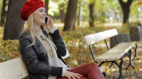 Thumbnail for Woman in Red Beret Speaking on Phone