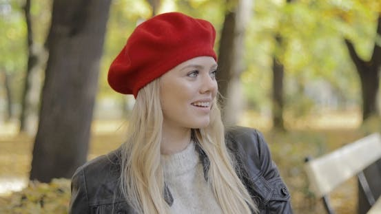 Thumbnail for Woman in Red Beret Sitting on Bench