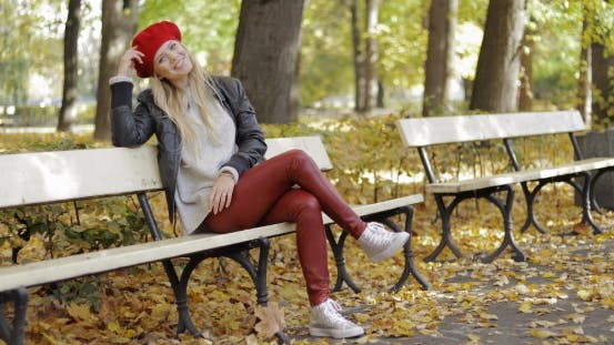 Thumbnail for Woman in Leather Jacket Sitting on Bench