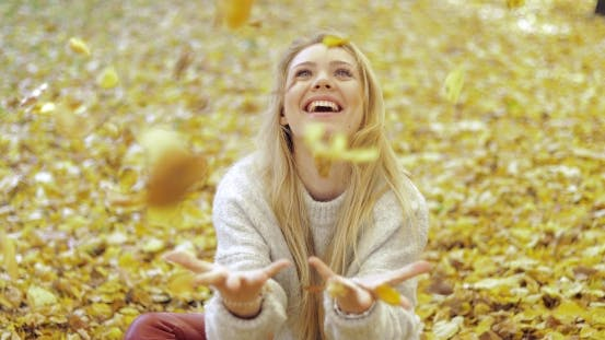 Thumbnail for Woman Rejoicing at Falling Leaves