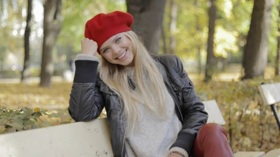 Thumbnail for Woman in Beret Leaning Head on Hand