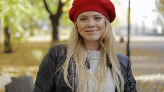 Thumbnail for Attractive Woman in Red Beret in Park