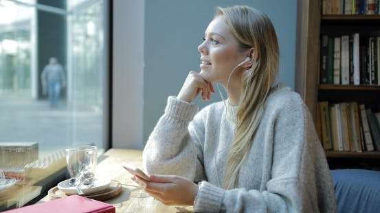 Thumbnail for Woman Looking at Window and Smiling