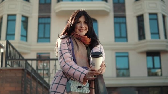 Thumbnail for Portrait of a Cute Young Woman Against the Backdrop of an Autumn City. a Girl in an Autumn Coat
