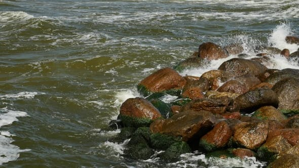 Thumbnail for Seawater Splashing on Seashore Rocks